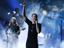 Dan Reynolds of Imagine Dragons performs a medley at the 41st American Music Awards in Los Angeles